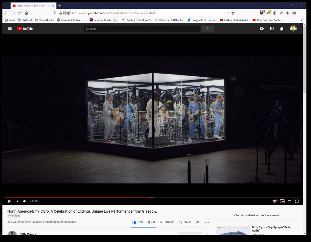 Screenshot of Biffy Clyro playing in a glass cube